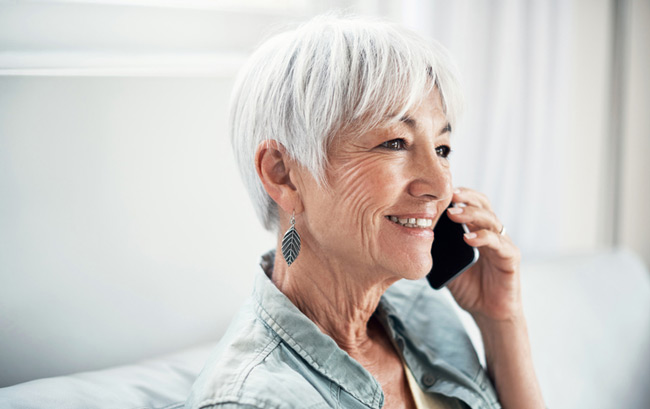 Woman calling to make appoint with Oregon Mobile Dentistry